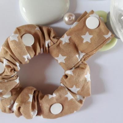 Bracelet porte sucette sucette marron étoiles