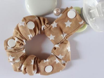Bracelet porte sucette sucette marron étoiles blanches