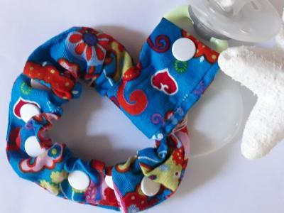 Bracelet porte sucette bleu imprimés fleuris
