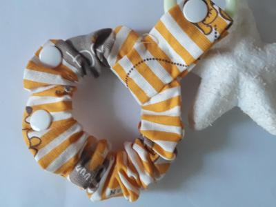 Bracelet porte sucette rayure orange