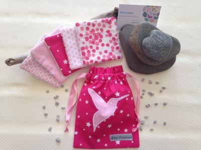 Pink pouch and cotton wipes